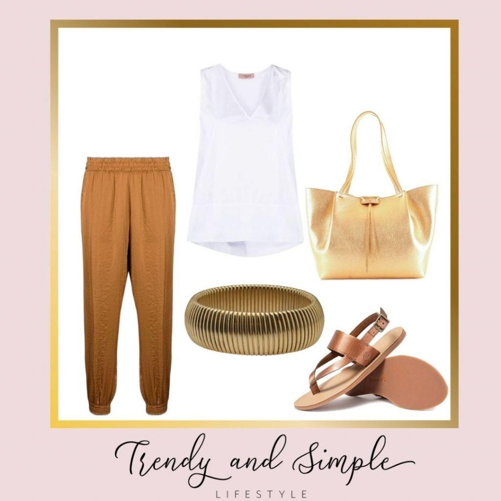 outfit donna estate 2021 commi chic. Pantaloni larghi, blusa bianca e accessori platino